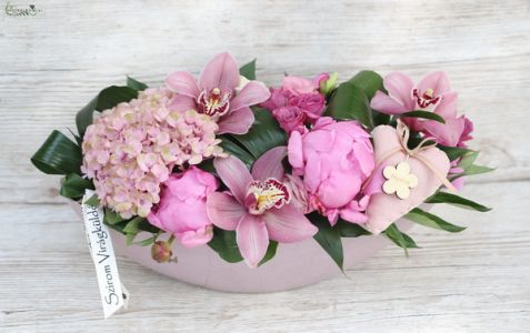 Pink flowerboat, with orchids and hydrangeas