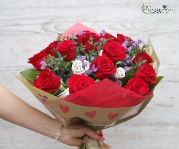 15 red roses in bouquet paper with hearts with small flowers