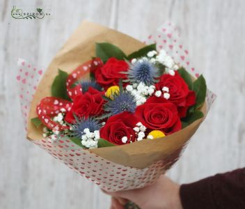 Small red rose bouquet with eryngiums, craspedias, bouquet paper with hearts