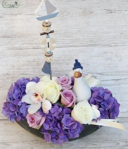 summer boat flower arrangement with seagull