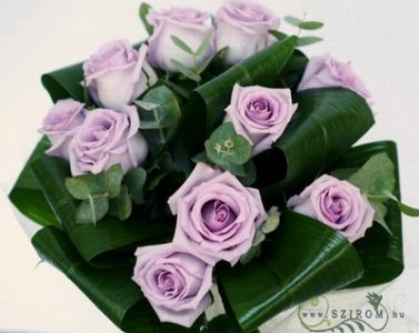 10 purple roses in a round bouquet