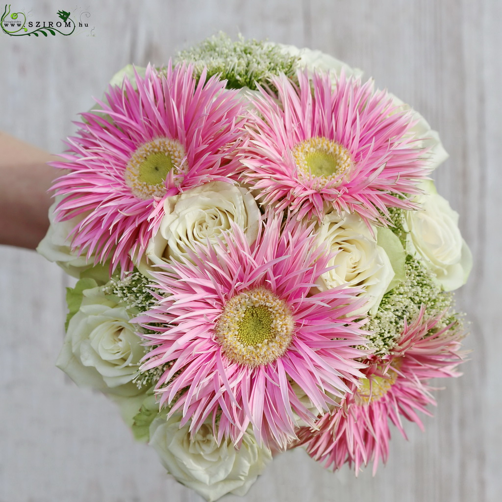 Bridal bouquet with white roses, pink spider gerberas