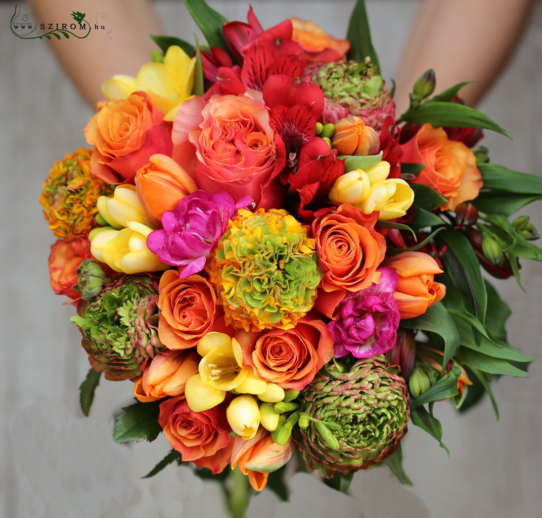 Bridal bouquet with orange spring flowers (freesia, tulip, rose, alstromeria, buttercup)