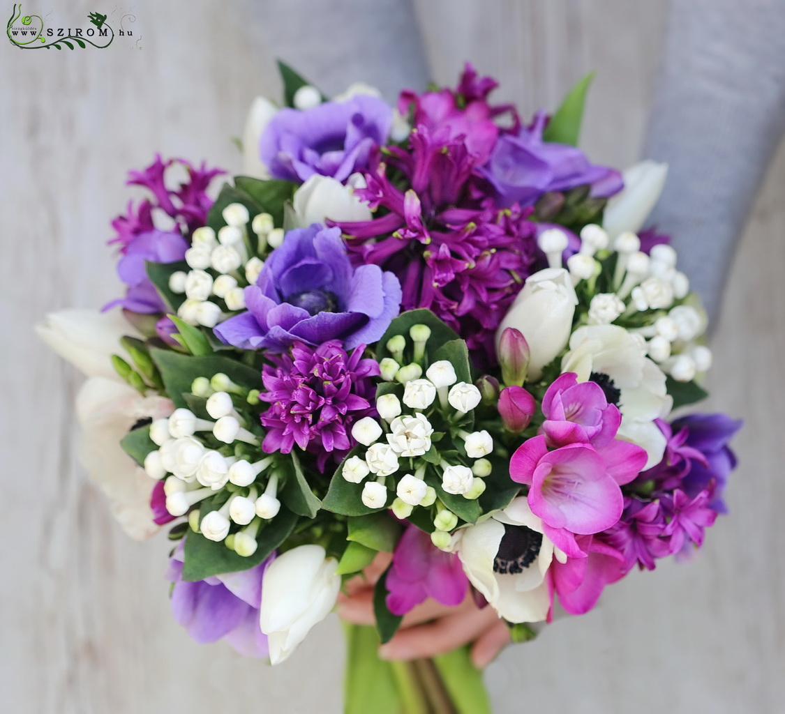 Bridal bouquet with purple spring flowers  (tulip, freesia, anemone, bouvardia, hyacinth)