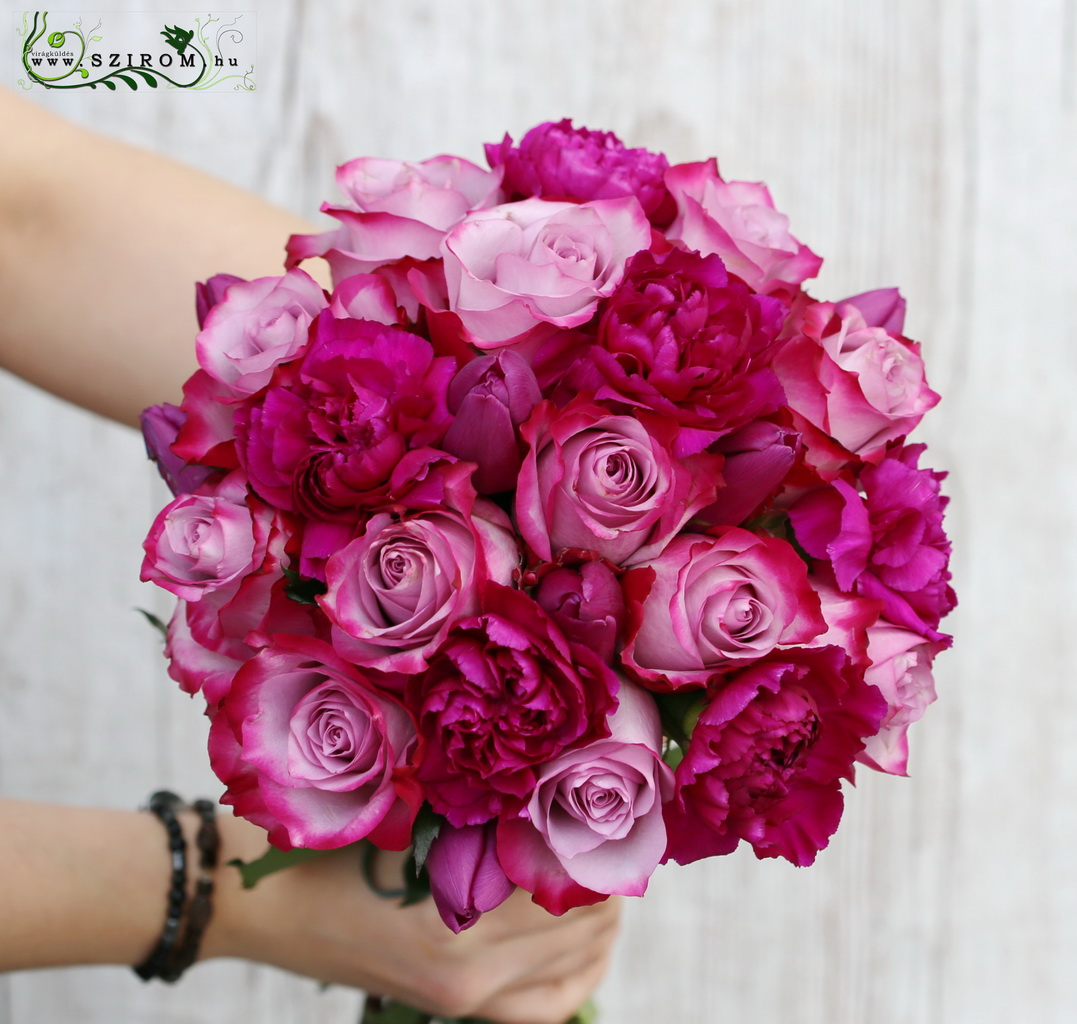 Bridal bouquet with purple carnations and roses