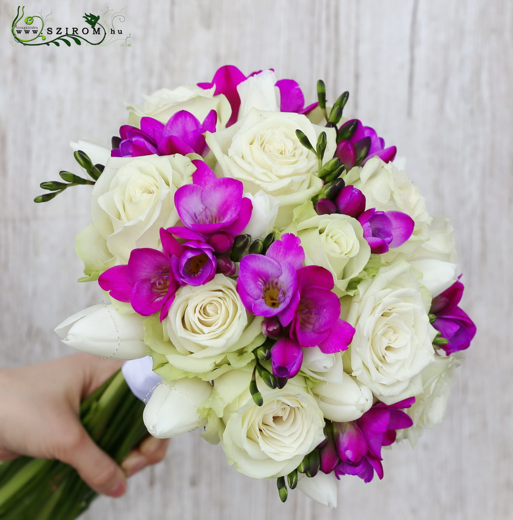 Bridal bouquet with white roses and freesias, purple freesias