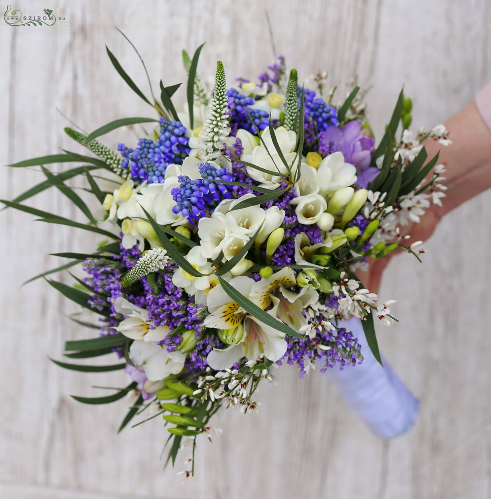 Shaggy bridal bouquet with spring flowers