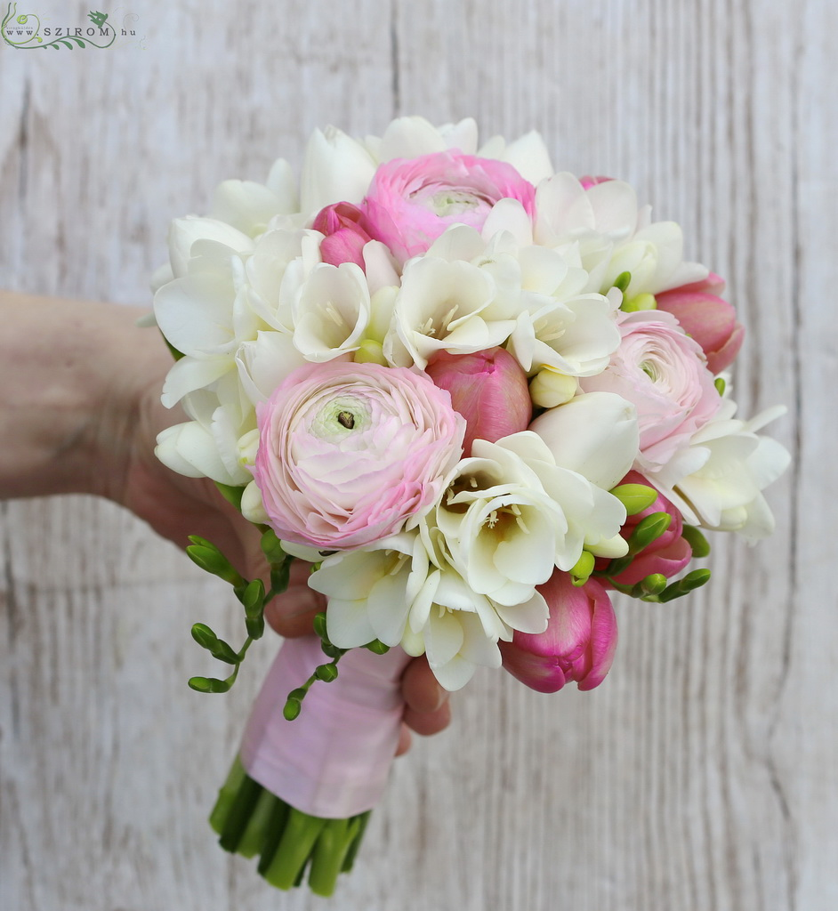 Bridal bouquet withpink and white spring flowers (freesias, tulips, ranunculusses)