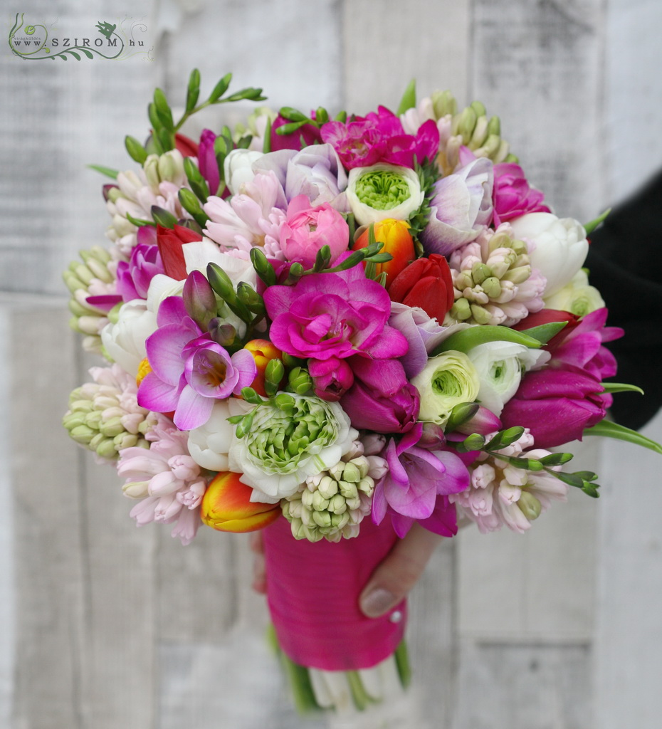 Bridal bouquet with colorful spring flowers (frézia, hyacinth, bouquet, tulip, pink, orange, white)