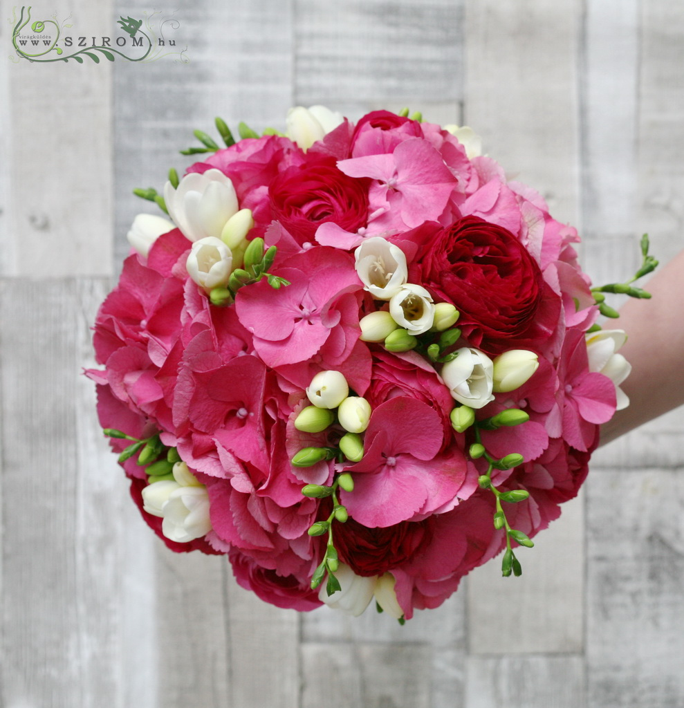 Bridal bouquet with hydrangea, freesia, ranunculus. (pink, white)