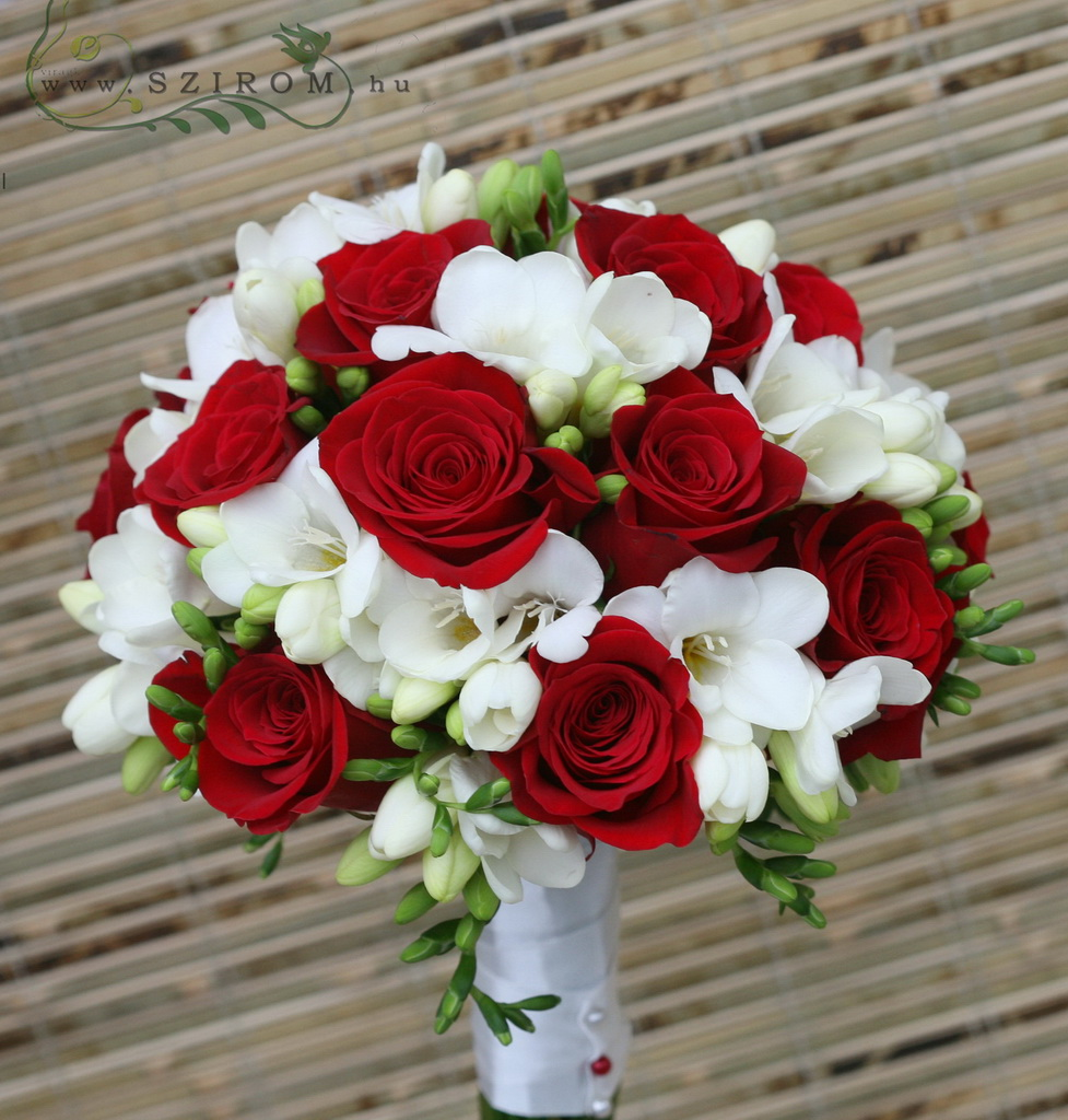 Bridal bouquet with red roses, and freesias (red, white)