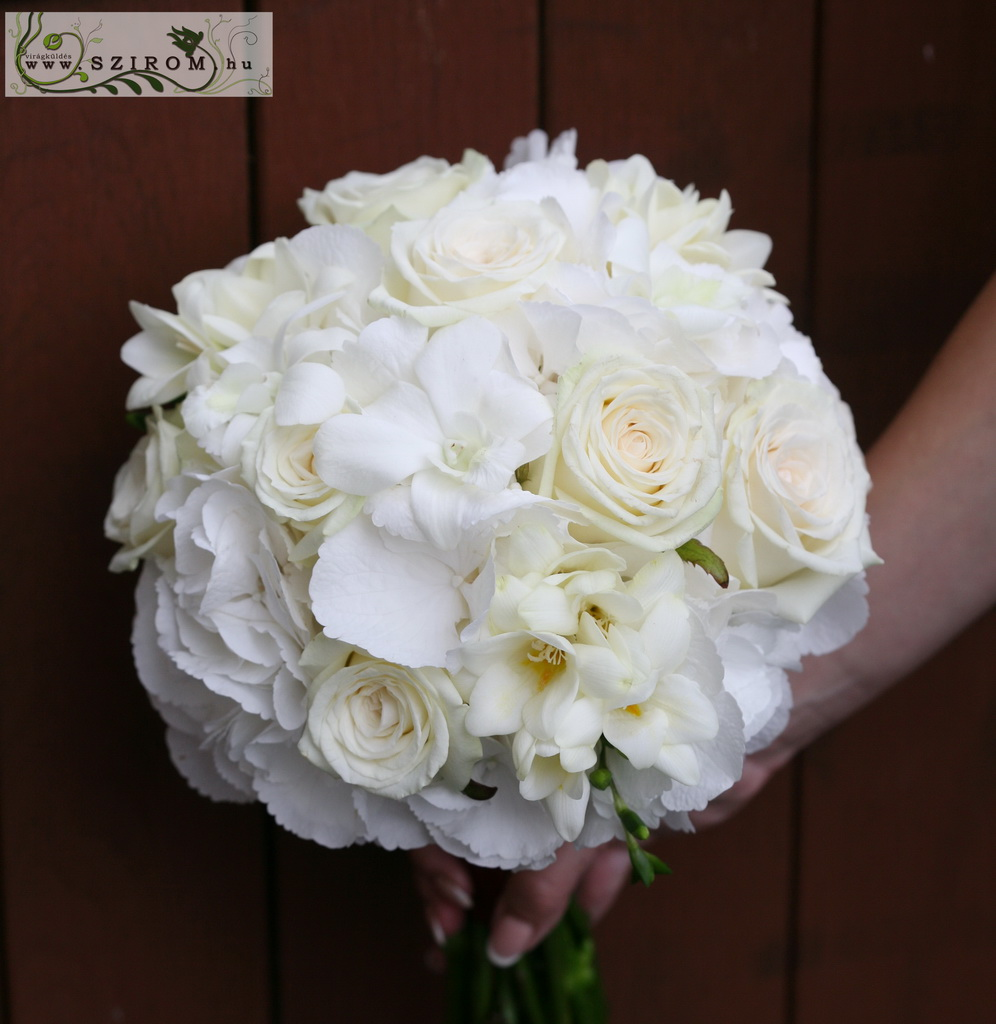 Bridal bouquet with white freesias, hydrangeas, roses, dendrobium ( white)