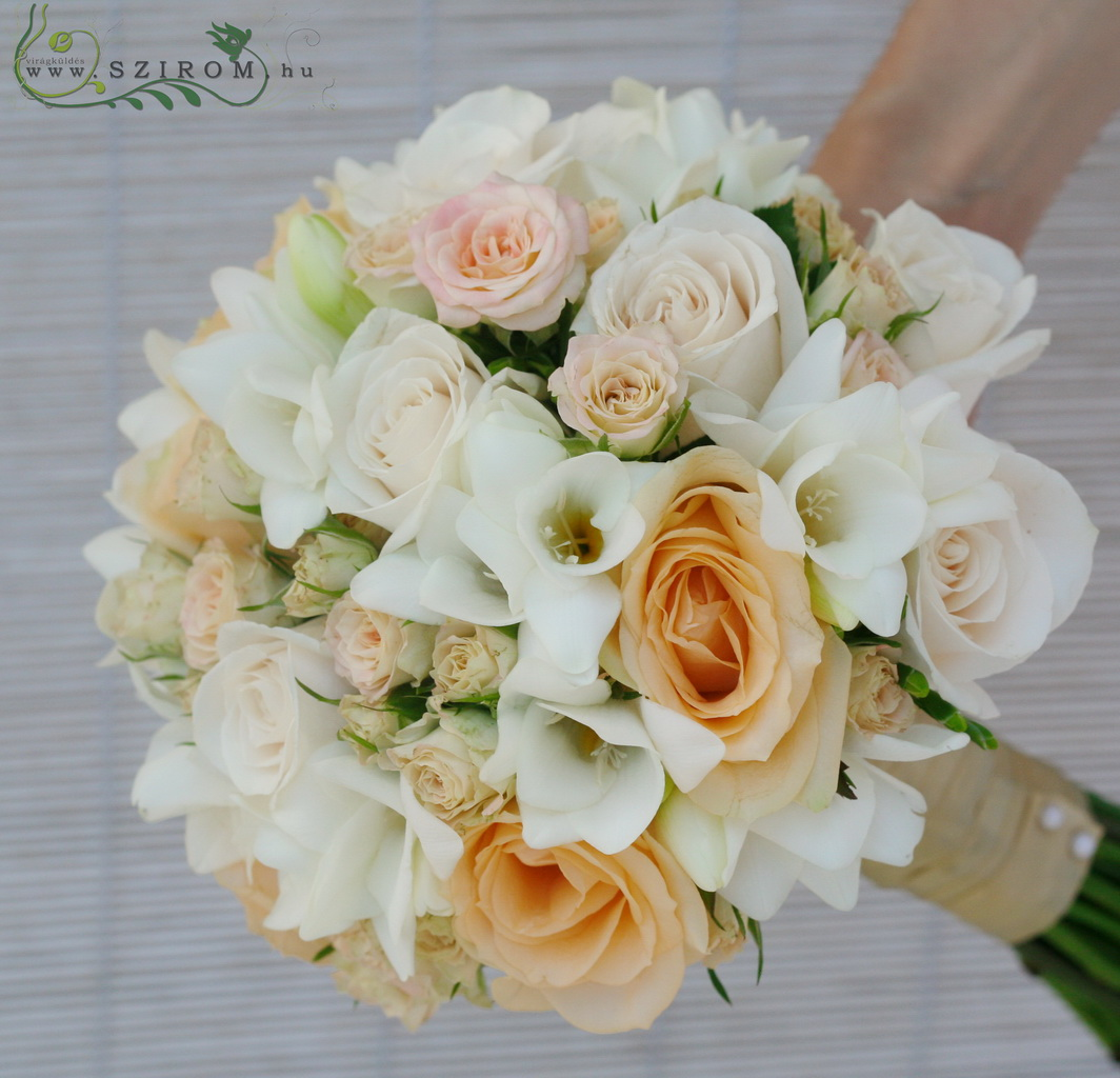 Bridal bouquet with peach roses, spray roses, freesias (white, peach)