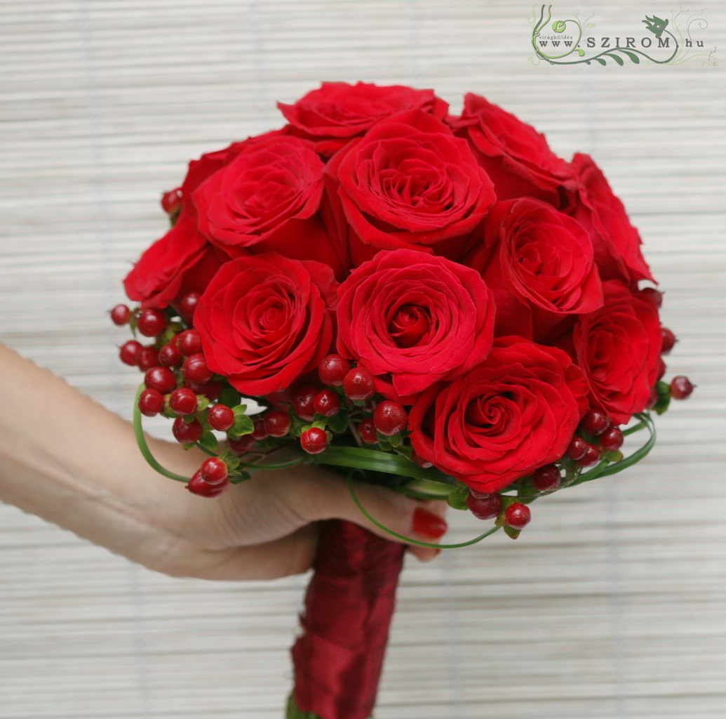Bridal bouquet of red roses and hypericum berries (red)