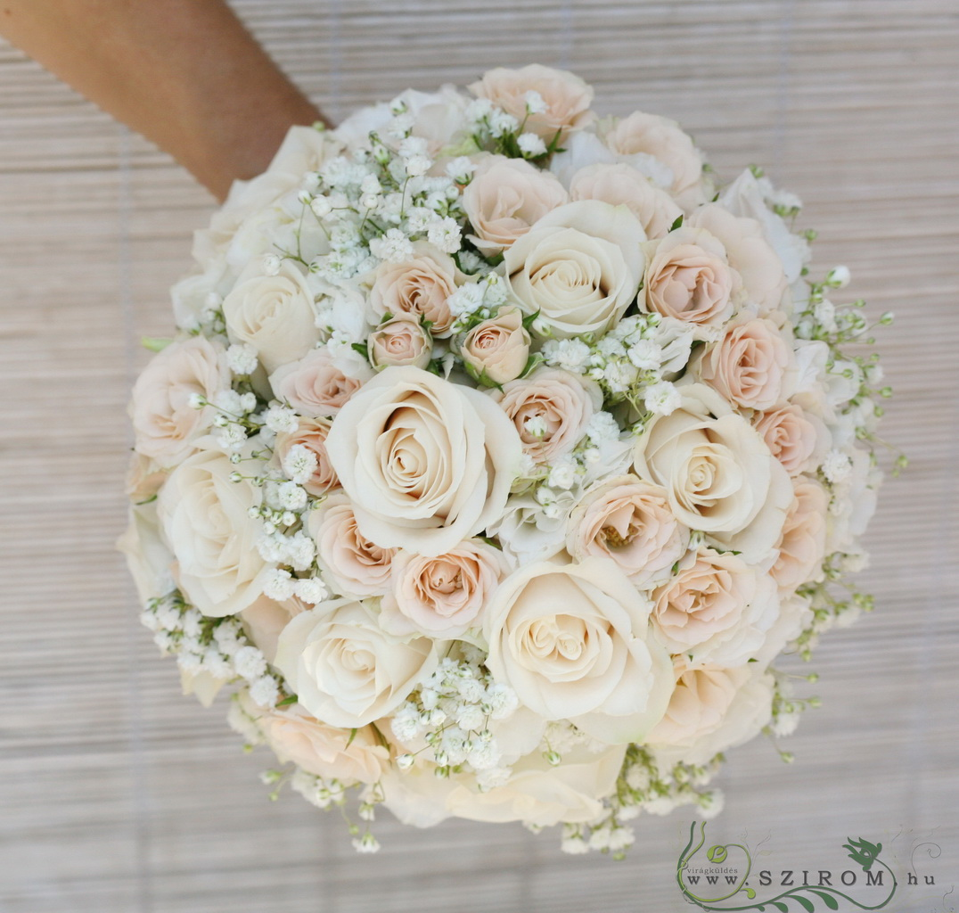 Bridal bouquet with roses, spray roses, lisianthusses, baby's breath. (white, peach)