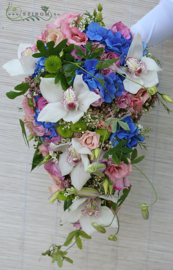 Bridal bouquet with golgotha (liziantus, hydrangea, cymbidium, wax, suede, santini, white, blue, pink, green)