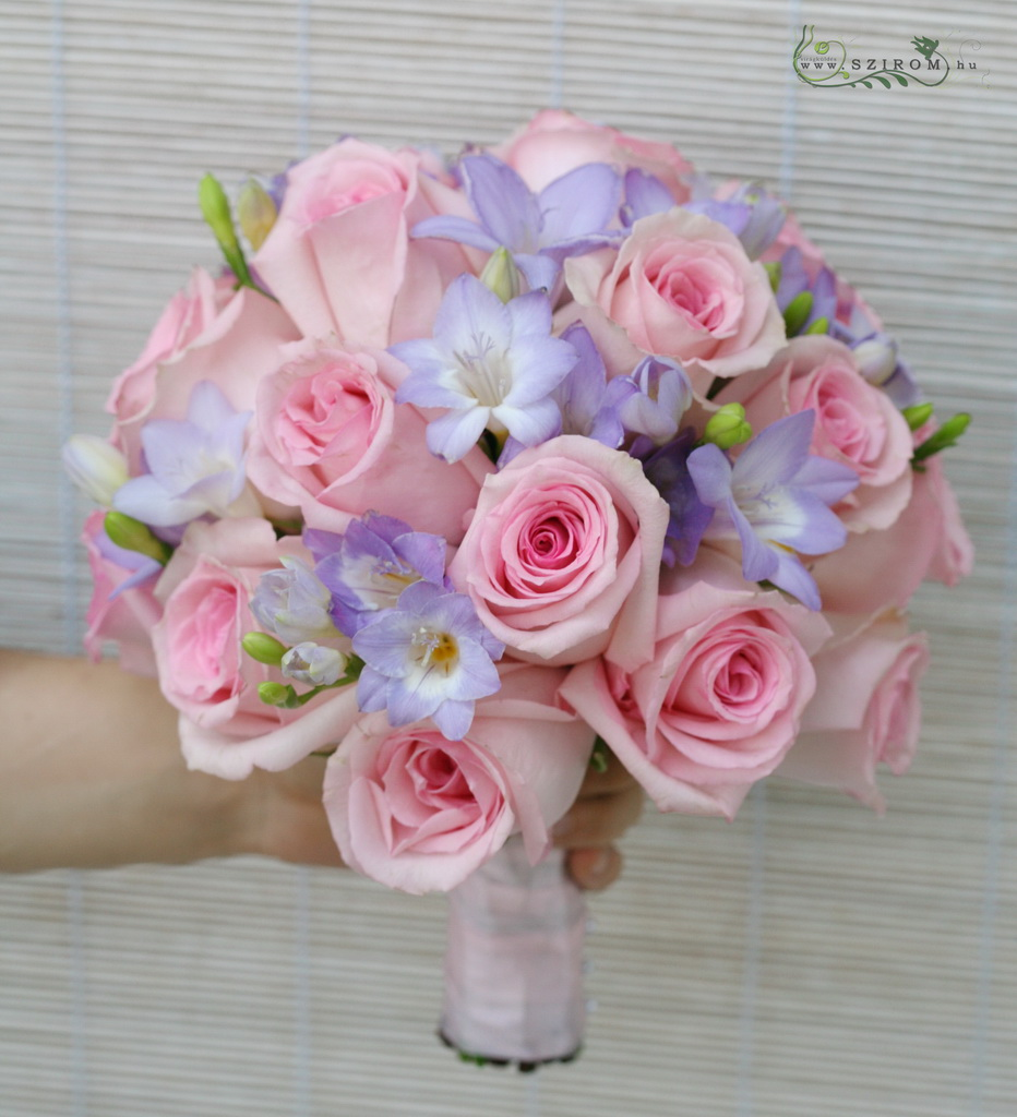 Bridal bouquet with roses and freesias (purple, pink)