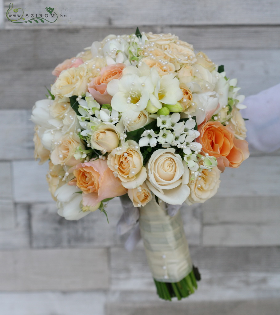 Bridal bouquet of peach roses, white tulips, bouvardias and freesias (white, peach)