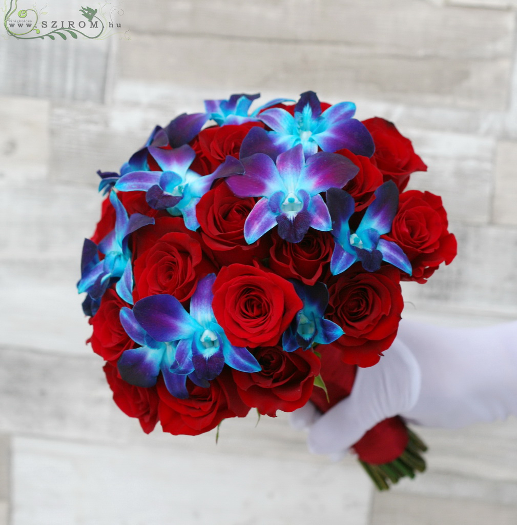 Bridal bouquet of red roses and blue dendrobiums