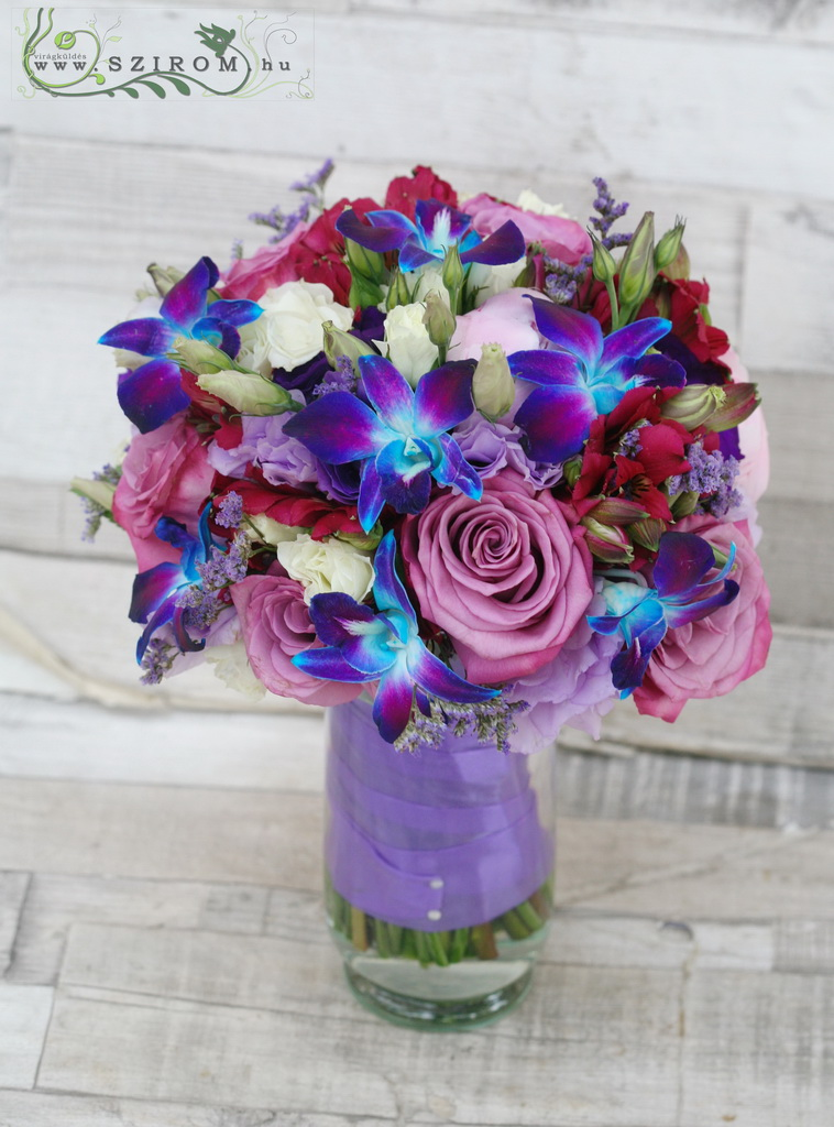 Bridal bouquet with purple roses, blue dendrobium