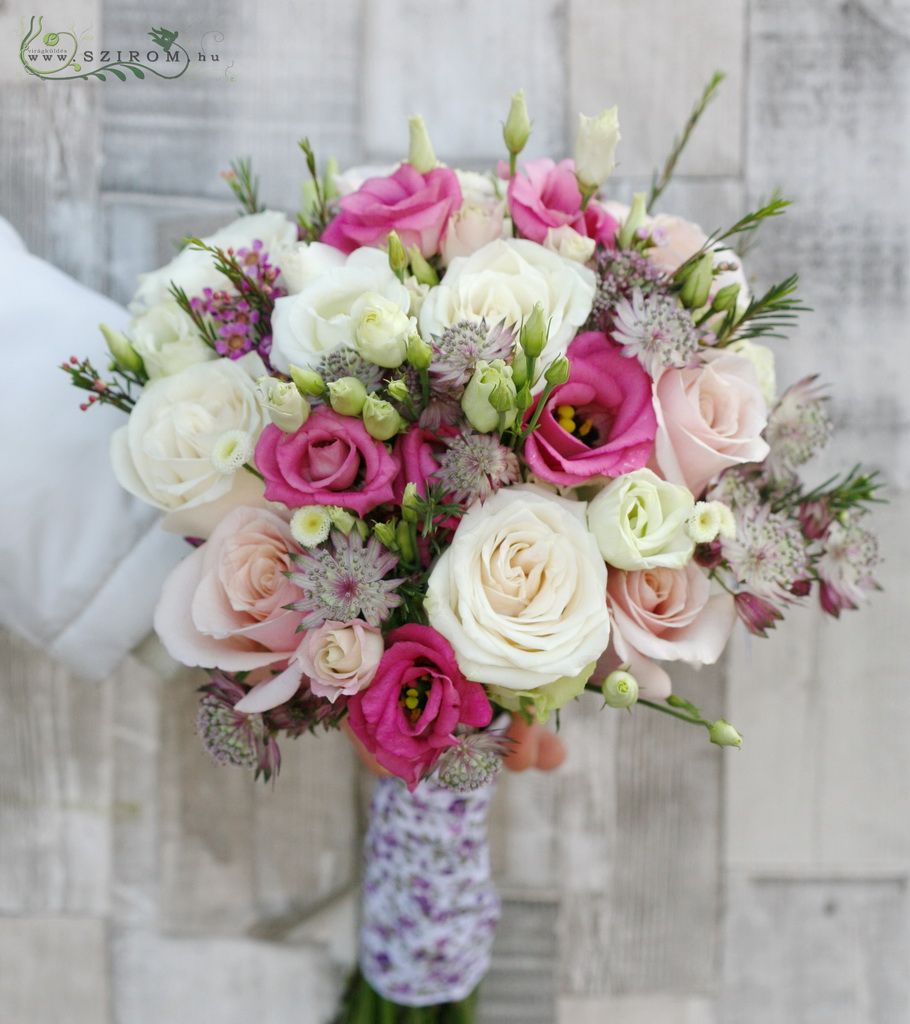Bridal bouquet with purple astrantias, pink lisianthusses, white roses