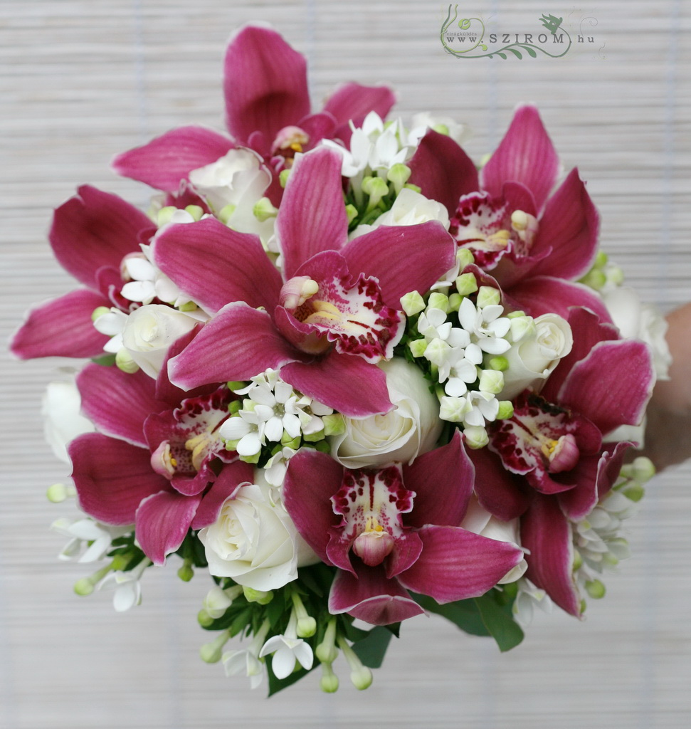 Bridal bouquet with corchids and bouvardias (rose, white, pink)