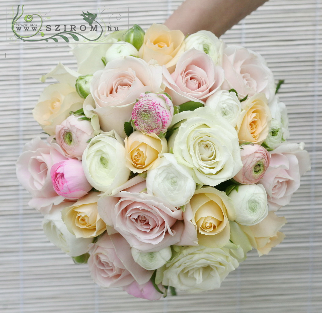 Bridal bouquet of pastell roses and ranunculuses (peach, white, pink)