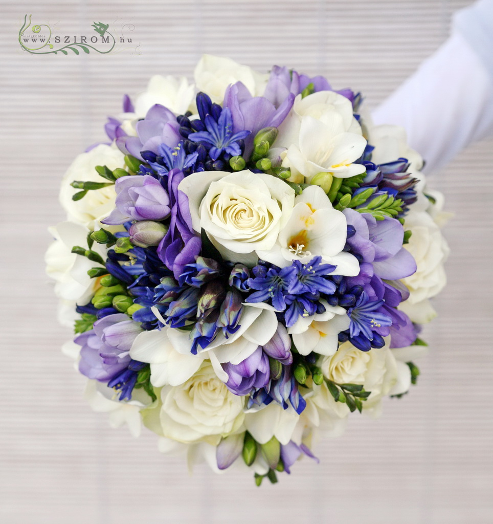 Bridal bouquet with freesias, blue agapanthusses and white roses
