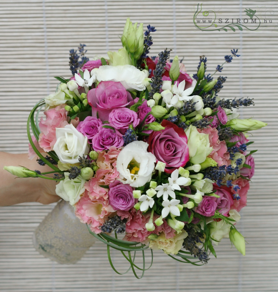Bridal bouquet of purple lavenders, roses, lisianthusses, bouvardias (purple, pink, white)