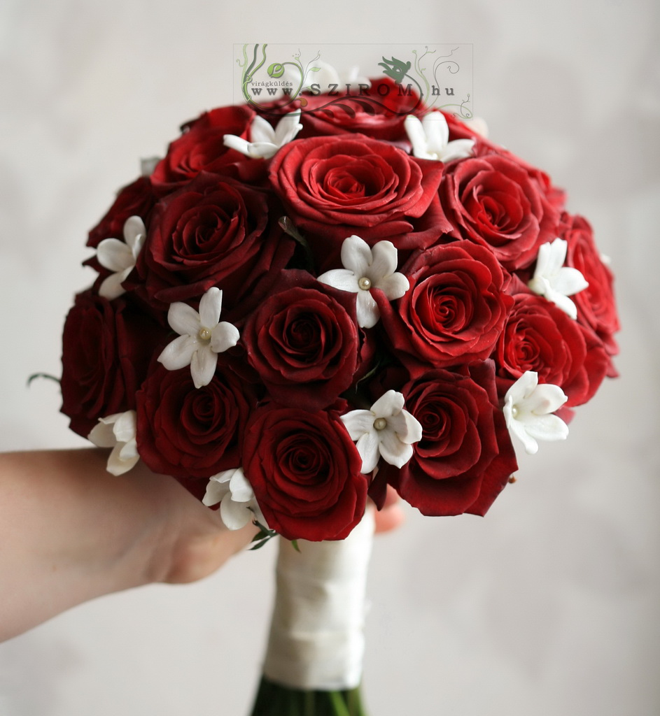 Bridal bouquet with red roses and stephanotis flowers