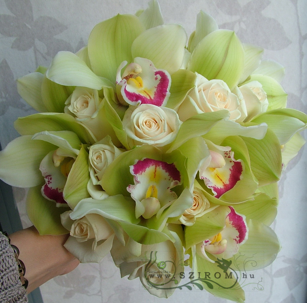 Bridal bouquet with green orchids, cream roses