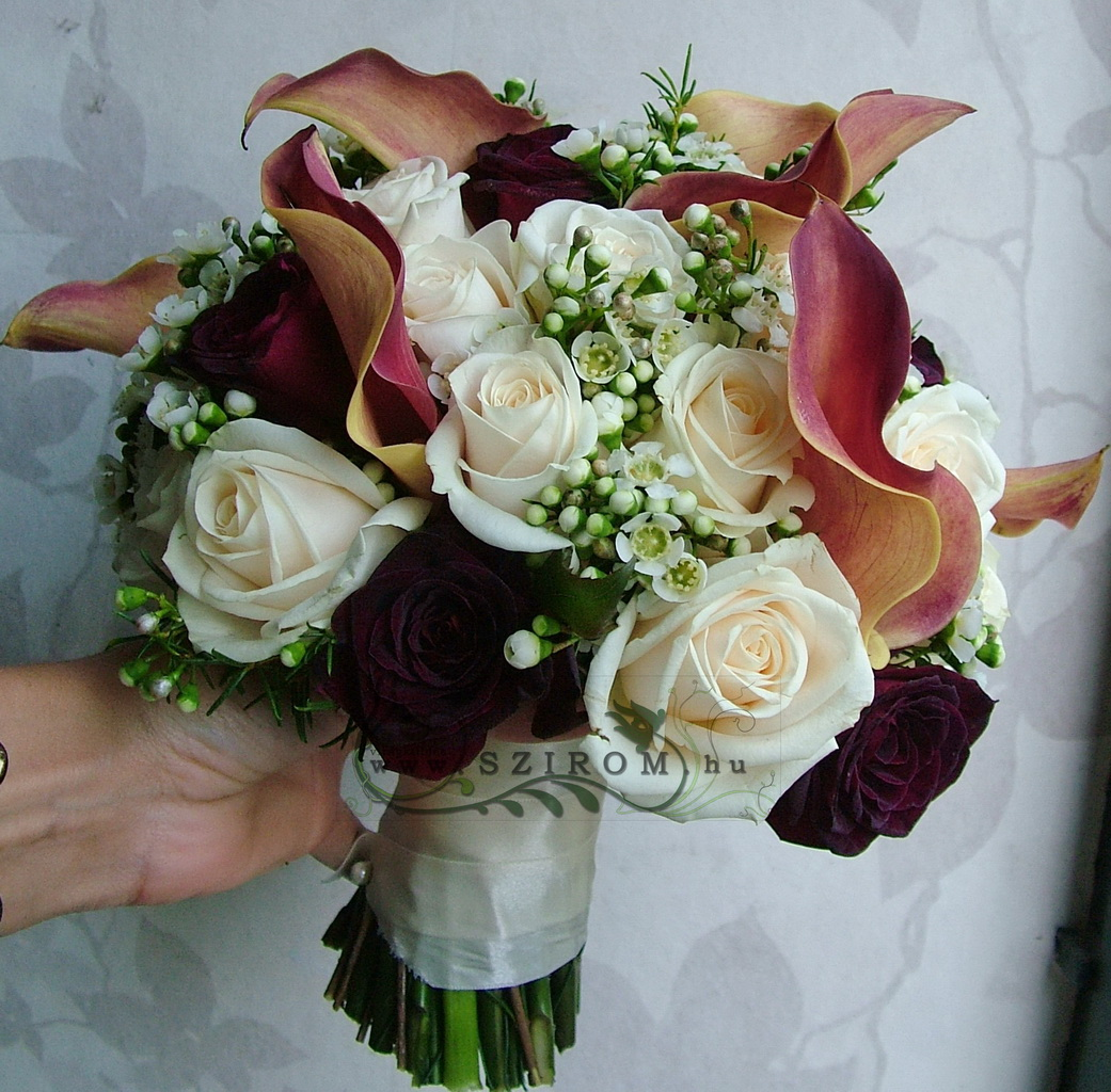Bridal bouquet of callas, roses and waxflowers (white, red, peach, red)