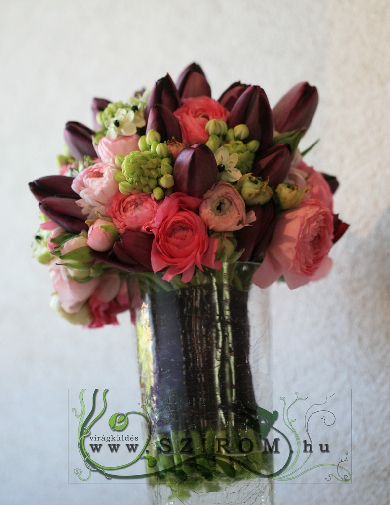 Bridal bouquet with tulips and ranunculuses (ornithogalum, purple,pink)