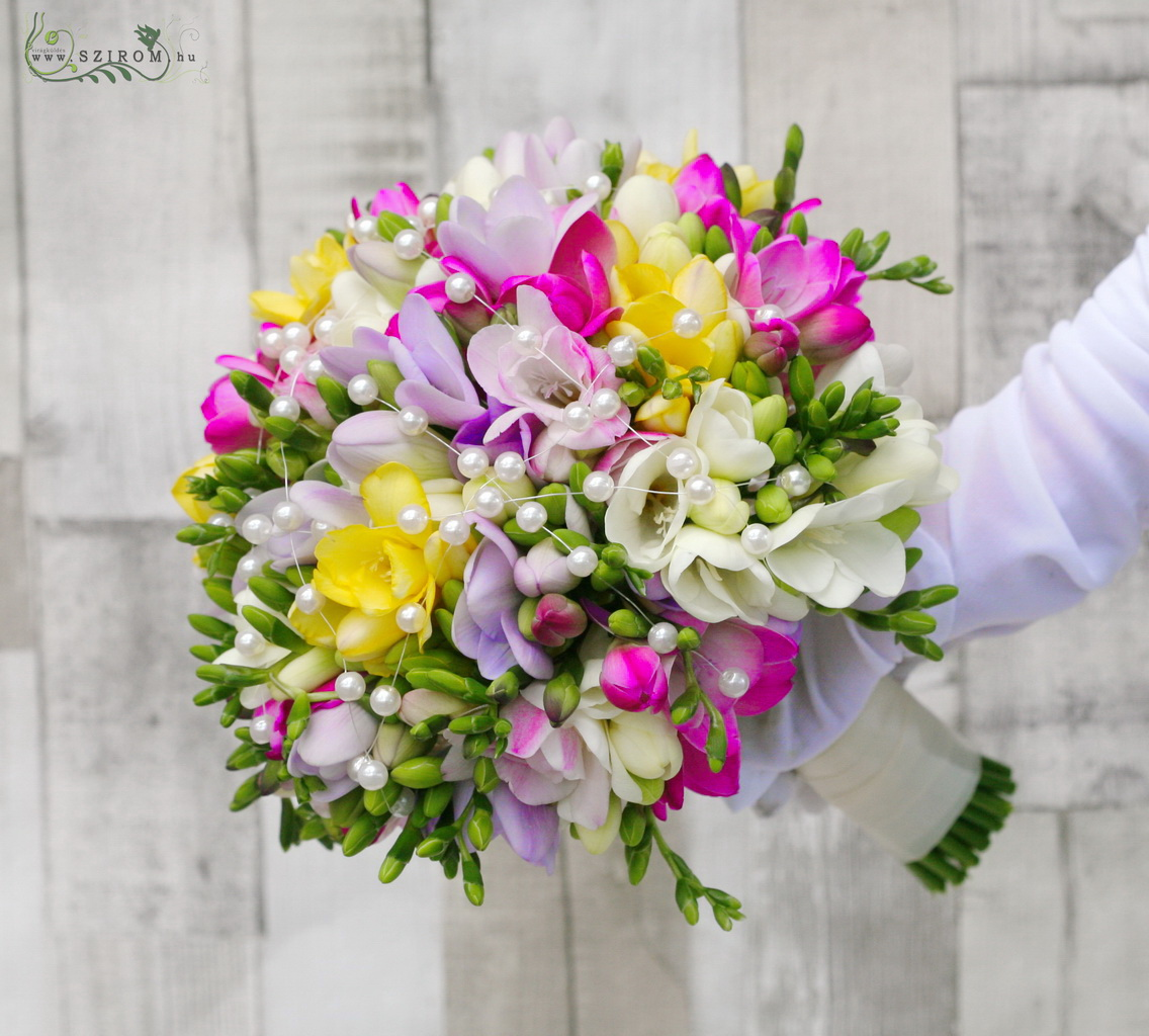 Bridal bouquet made of freesia with decor pearls (yellow, pink, purple)