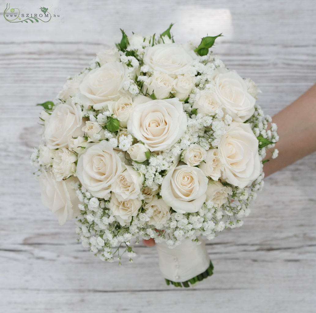 bridal bouquet ( roses, spray roses, baby breath, cream )
